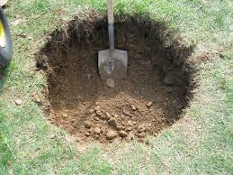 shovel in hole