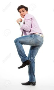 9096879-Scared-man-running-away-with-grimace-in-his-face-wearing-jeans-shirt-and-tie-Stock-Photo